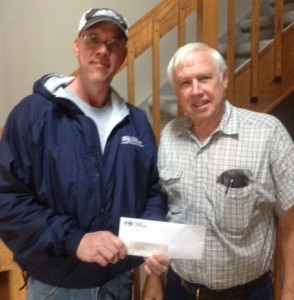 Don Ellis from Central Valley Ag presents an equity check to James Luethje of York, NE.